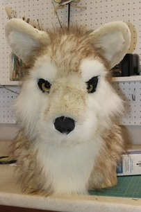 fur sewn together but not glued down to resin base
